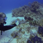 This is Victor taking a photo of a Nassau Grouper.